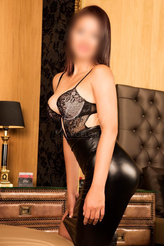 Luiza: High class brunette escort for couples in Barcelona, wearing a black dress